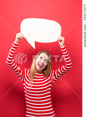 Young woman holding a speech bubble 44673975