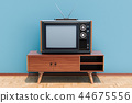 Retro TV set on the stand in room 44675556