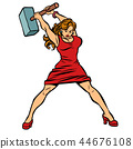 woman blacksmith in dress, big hammer in hand 44676108