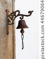 Vintage old metal bell hang on stone arch 44679064