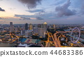 Skyline of Singapore with famous Singapore Ferries Wheel day to night timelapse at twilight 44683386
