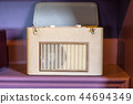 Old retro radio receiver on shelf 44694349