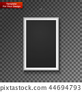 Blank paper frame on wall 44694793