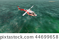 Helicopter flying over the pacific ocean on a sunny day. 3D Rendering 44699658