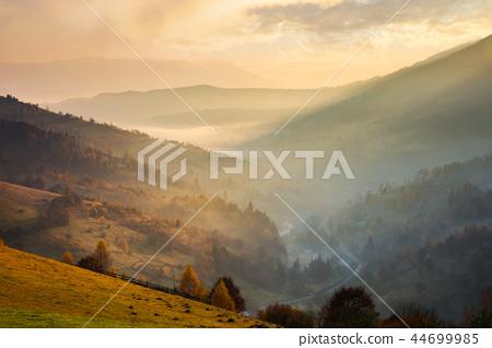 amazing glowing sunrise in mountains 44699985