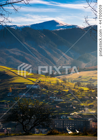 village in valley. distant mountain with snowy top 44700009
