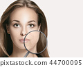beauty, aging, people, skincare and health concept - beautiful young woman face with wrinkles over 44700095