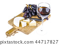Camembert cheese with black grapes on wooden board 44717827