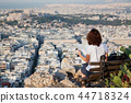 woman with a map sitting on Lycabettus Hill 44718324