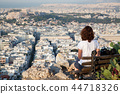 woman with a map sitting on Lycabettus Hill 44718326