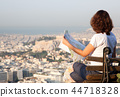 woman with a map sitting on Lycabettus Hill 44718328