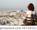 woman with a map sitting on Lycabettus Hill 44718331