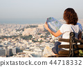woman with a map sitting on Lycabettus Hill 44718332