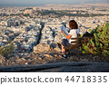 woman with a map sitting on Lycabettus Hill 44718335