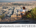 woman with a map sitting on Lycabettus Hill 44718336