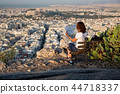 woman with a map sitting on Lycabettus Hill 44718337