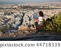 woman with a map sitting on Lycabettus Hill 44718339