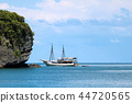 White sailboat in the sea with view of the island 44720565