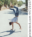 Young man break dancing on the road. 44729107