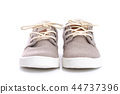 Close up of kids sneakers on white background 44737396
