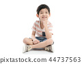 Cute Asian child sitting on white background  44737563
