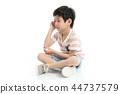 Close up of sad Asian boy sitting  44737579