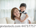 Asian child on a piggy back ride with his mother 44737757