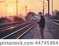 Man waiting at railroad station 44745964
