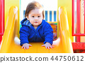 Toddler boy playing on the playground 44750612