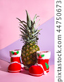 Christmas Santa's boot with pineapple on duotone background with copy space 44750673