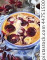 Autumn dessert. Red plums clafoutis and coffee 44751500