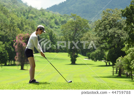 Asian woman playing golf  44759788