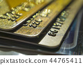 Gold and platinum credit cards close up 44765411