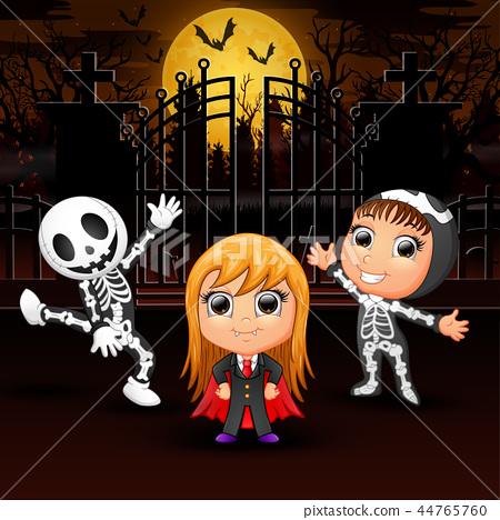 Happy kids wearing halloween costume outdoors at n 44765760