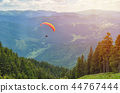 Paraglider taking off in front of mountain scenery 44767444