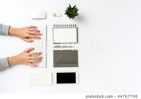 Overhead shot of woman working in office. 44767798