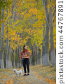 Teen girl with a maltese dog 44767891