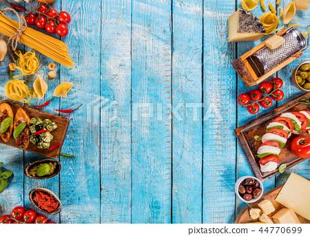 Various kind of italian food served on wood 44770699