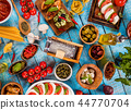 Various kind of italian food served on wood 44770704