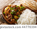Spicy Indian chicken Do Pyaaza with onions 44776394
