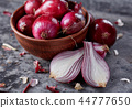 Fresh onion for salad on a grey surface 44777650
