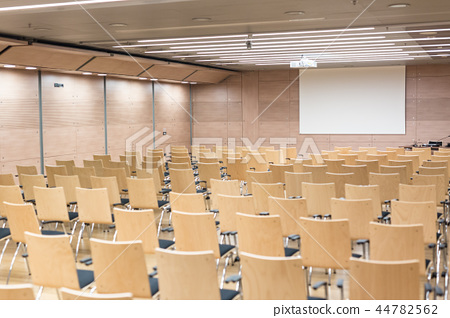 Empty wooden seats in a cotmporary lecture hall. 44782562