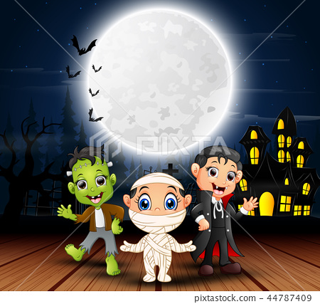 Happy halloween kids with scary house and full moo 44787409