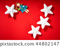christmas white stars and fabric angel on a red background 44802147