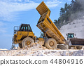 Dump truck working with excavator in Marble Quarry 44804916