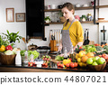 Woman with fruits and vegetables 44807021