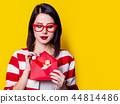 woman with christmas gifts  44814486