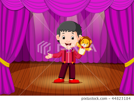 a boy playing puppet in the stage 44823184