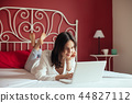 woman, bed, laptop 44827112