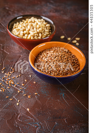 Cup with pine nuts and flax seeds 44835305